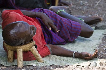 LAKE TURKANA, KENYA - JANUARY 12  El molo man resting on traditional  head rest   January 2013 at Lake Turkana  Stock Photo - 17950295