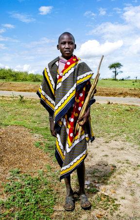 MAASAI MARA, KENYA-DESEMBER 27  Teenager Maasai in traditional clothes 27 Desember, 2012 at Maasai Mara, Kenya  The Maasai are the most famous tribe in Africa