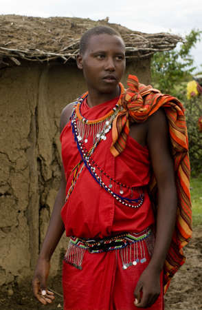 MAASAI MARA, KENYA-DECEMBER 27  Maasai in traditional clothes 27 December, 2012 at Maasai Mara, Kenya  The Maasai are the most famous tribe in Africa   Stock Photo - 17950293