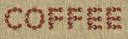 lettering from the coffee beans on fabric background photo