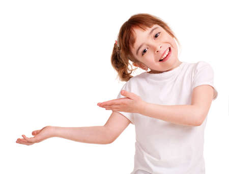 kid pointing: Smiling little girl showing empty hand, Isolated on white