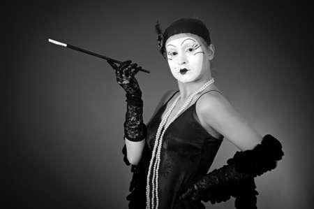 retro portrait of smoking mime over dark background  photo