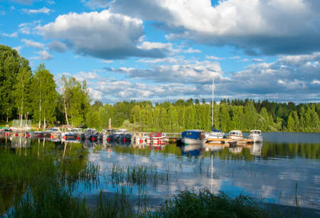 Boats on the lake in Jyvaskyla, Finland Reklamní fotografie - 20858908