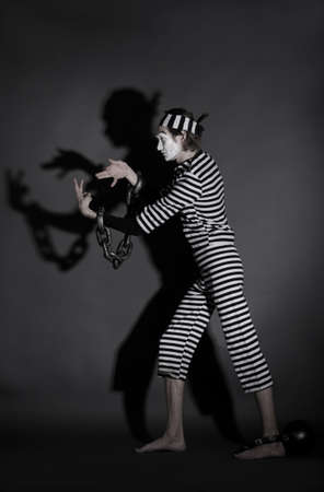 prisoner of love: portrait of mime prisoner over dark background  Stock Photo