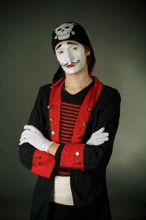 portrait of mime pirate over dark background  photo