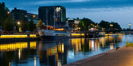 TURKU, FINLAND 29 JUNE: View to the Aura river at night in Turku,Finland on 29 june, 2013. Nightlife on the banks of river Aura, where are bars and restaurants. Turku is  one of popular tourist destinations.  Stock Photo - 21416854