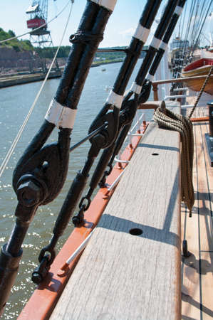 Black metal rigging and ropes on a deck of sail ship  photo