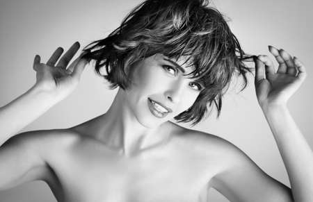 portrait of a beautiful young woman with short hairs  photo