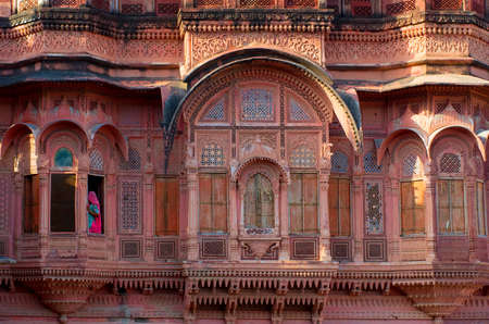 Woman at window in Mehrangarh Fort in Jodhpur, Rajasthan,  India
