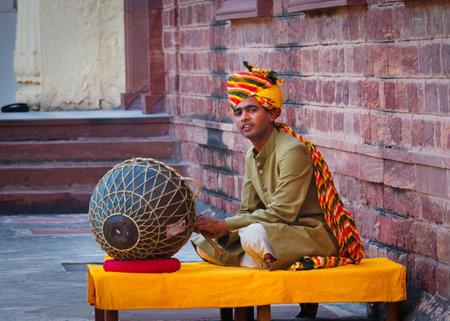 JODHPUR, INDIA - SERT 20:  Indian musician in traditional dress playing musical instruments in Meherangarh fort, on sept 20, 2013 in Jodhpur, India