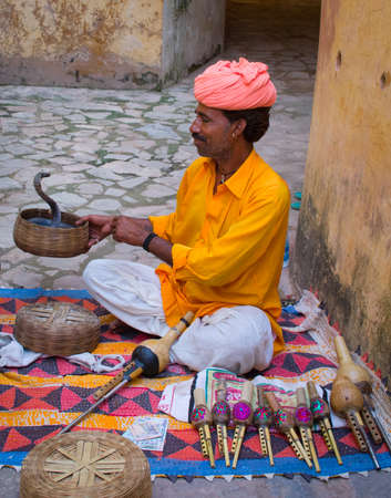 JAIPUR, INDIA-SEPT 26 : Snake charmer in Amber Fort Sept 26, 2013 in Jaipur, India. Performance of snake charmers is very popular among tourists.