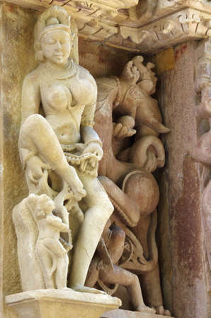 Stone carved erotic bas relief in Hindu temple in Khajuraho, India.  photo