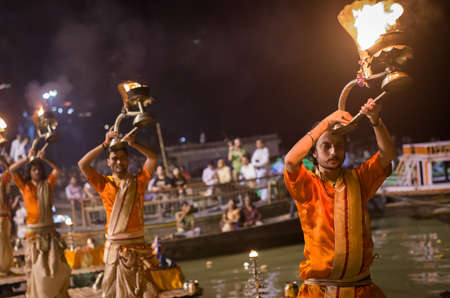 VARANASI, INDIA-30 SEPT:A Hindu priest performs the Ganga Aarti ritual on 30 Sept, 2013 in Varanasi.Fire puja is a Hindu ritual that takes place at Dashashwamedh Ghat on the banks of the river Ganges