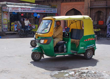 auto rickshaw: JODHPUR, INDIA - SEPT 20: Auto rickshaw taxi on sept 20, 2013 in Jodhpur, India. These taxis are popular type of transport among locals and tourists. Editorial
