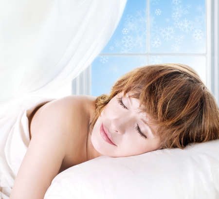 Portrait of the sleeping girl in front of a winter window photo