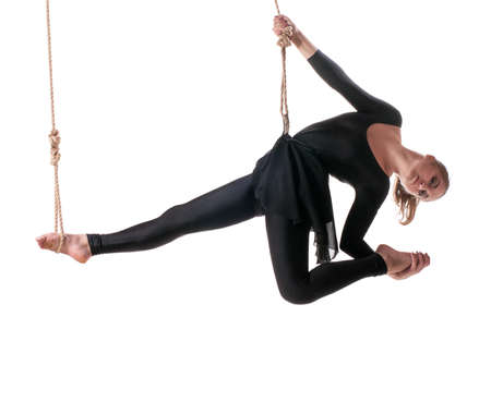 Young woman gymnast on rope on white background  photo