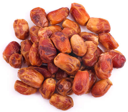 deglet: dried dates on white background  Stock Photo