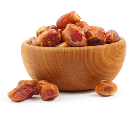 dates fruit: Wooden bowl full of dates isolated on the white background Stock Photo