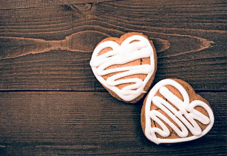 Homemade ginger cookies heart shaped   over wooden table  Valentine photo