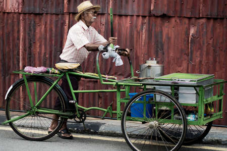 GEORGE TOWN, PENANG, MALAYSIA - AUG 17, 2011: A Street vendor on the street on Aug 17, 2011 in George Town, Malaysia.