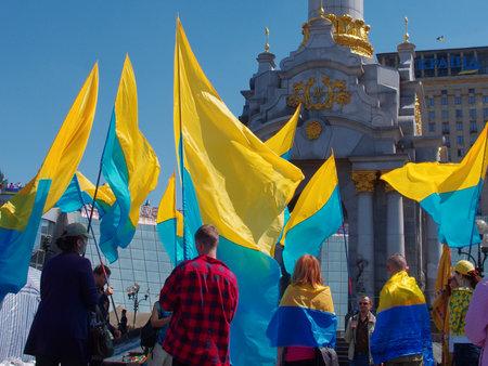 maidan: KIEV (KYIV), UKRAINE - MAY 11, 2014: People on the Maidan with inverted flag of Ukraine.