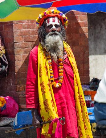 KATHMANDU, NEPAL - APRIL 04: Sadhu with traditional painted face at  Durbar Sqaure in Kathmandu, Nepal on April 04, 2014.