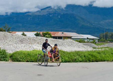 indigene: PAPUA PROVINCE, INDONESIA - DEC 27: A trishaw driver on the street   in Wamena, at island New Guinea, Indonesia on Dec 27, 2010.