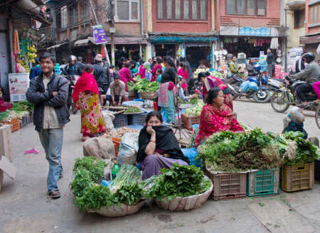 KATHMANDU, NEPAL - CIRCA APRIL 2014: The street vendor sels his fruits and vegetables in Thamel in Kathmandu, Nepal.