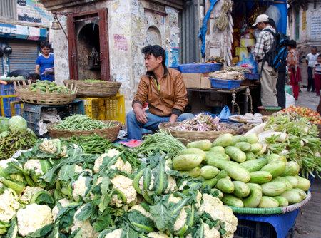 KATHMANDU, NEPAL - CIRCA APRIL 2014: The street vendor sels his fruits and vegetables in Thamel in Kathmandu, Nepal. Sajtókép