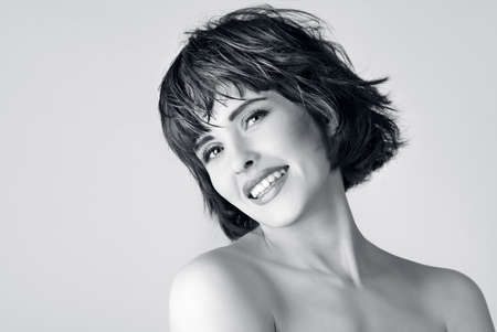 beautiful laughing woman with  short hair  photo
