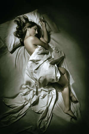 light blue lingerie: Young woman sleeping at night in bed  Stock Photo