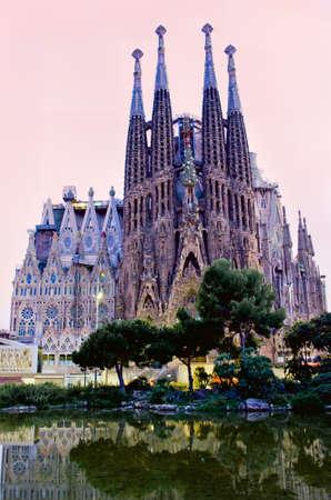 spain: BARCELONA, SPAIN - JULY 12, 2014: Sagrada Familia church (Temple Expiatori de la Sagrada Famalia) in Barcelona, Spain. Designed by Antoni Gaudi, UNESCO World Heritage Site.