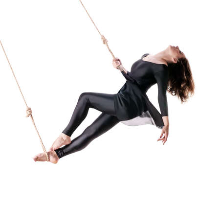 Young woman gymnast on the rope on white background  photo