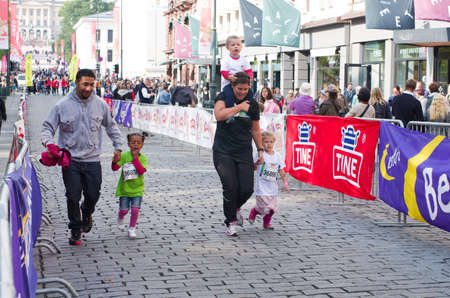 OSLO, NORWAY- SEPT 20:Children's Marathon for all children aged 0-12 years and a day of activities with an obstacle course, gymnastics, hockey and athletics  on Sept 20, 2014 in Oslo, Norway Stock Photo - 32969738
