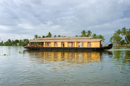 Kerala, India - October 18: Traditional Indian houseboat near Alleppey  on Kerala backwaters on October 18, 2014.