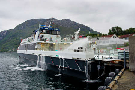 FORSAND, NORWAY - SEPT 23: Washing ferry in Forsand, after trip on the Lysefjord  on Sept 23, 2014, Norway