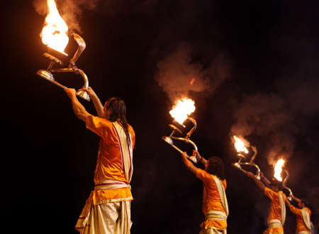 benares: VARANASI, INDIA-02 OCT:A Hindu priest performs the Ganga Aarti ritual on 02 Oct, 2014 in Varanasi.Fire puja is a Hindu ritual that takes place at Dashashwamedh Ghat on the banks of the river Ganges
