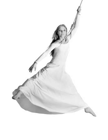 Young woman gymnast in white dress on rope. White background photo