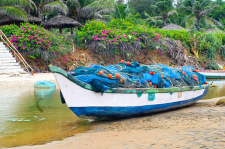 mamallapuram: Fishing boats beached along the coast  in Mamallapuram, Tamil Nadu, India