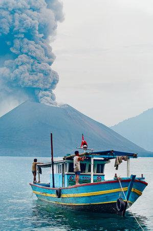 eruptive: INDONESIA - JANUARY 20:  Boat near volcano Anak Krakatau during  eruption on January 20, 2011.