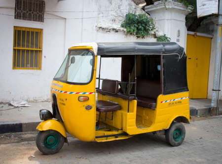 auto rickshaw: PONDICHERRY (PUDUCHERRY), INDIA - OCT 12, 2014: Auto rickshaw or tuk-tuk on the street  in Pondicherry also known as Puducherry, India, on 12 Oct 2014