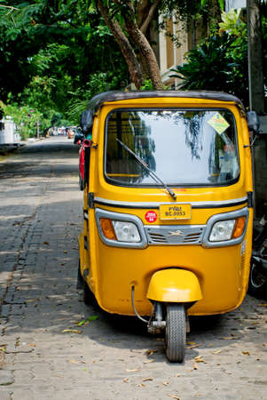 three wheeler: PONDICHERRY (PUDUCHERRY), INDIA - OCT 12, 2014: Auto rickshaw or tuk-tuk on the street  in Pondicherry also known as Puducherry, India, on 12 Oct 2014