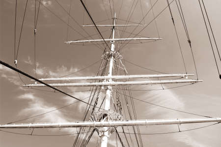 rope ladder to the main mast of the ship on blue sky background photo