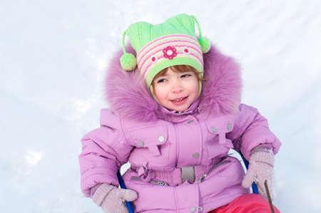 The laughing girl  sledging, nice winter scene photo