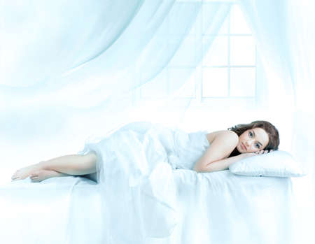 bed sheet: Beautiful woman sleeping front of the window
