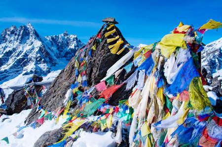 ri: mountain scenery from gokyo ri with prayer flags - Nepal