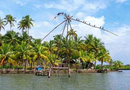 chinese fishing nets: Chinese traditional fishing net in Kerala, India Stock Photo