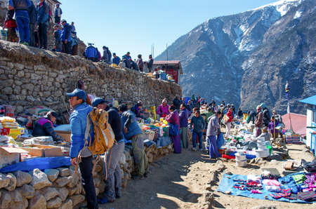 bazar: NAMCHE BAZAR,NEPAL-MARCH 7: Traditional Saturday market  in  Namche Bazar  on March 7,2014 Khumbu district, Himalayas, Nepal Editorial