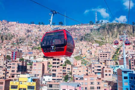 ropeway: LA PAZ, BOLIVIA - APR 03, 2015: Cable cars carry passengers in La Paz. Aerial cable car of urban transit system opened in 2014 in the Bolivian city of La Paz. Editorial