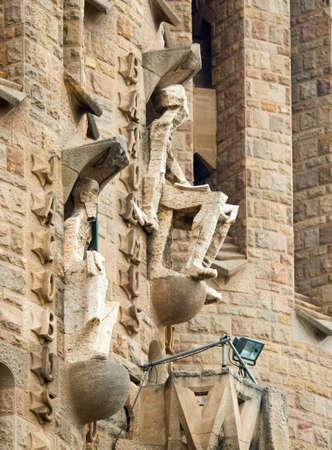 symbolic: BARCELONA, SPAIN - MARCH 04, 2015: Detail of Sagrada Familia church (Temple Expiatori de la Sagrada Famalia) in Barcelona, Spain. Designed by Antoni Gaudi, UNESCO World Heritage Site.